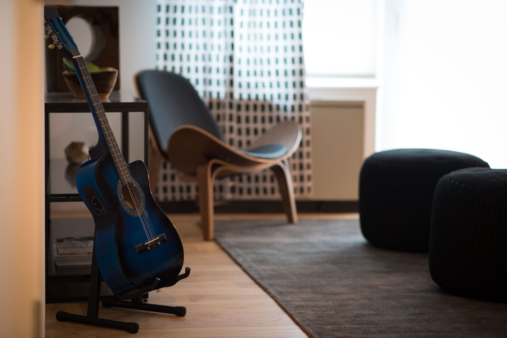 A guitar sits in a living area at The Vitagraph Apartments in Brooklyn
