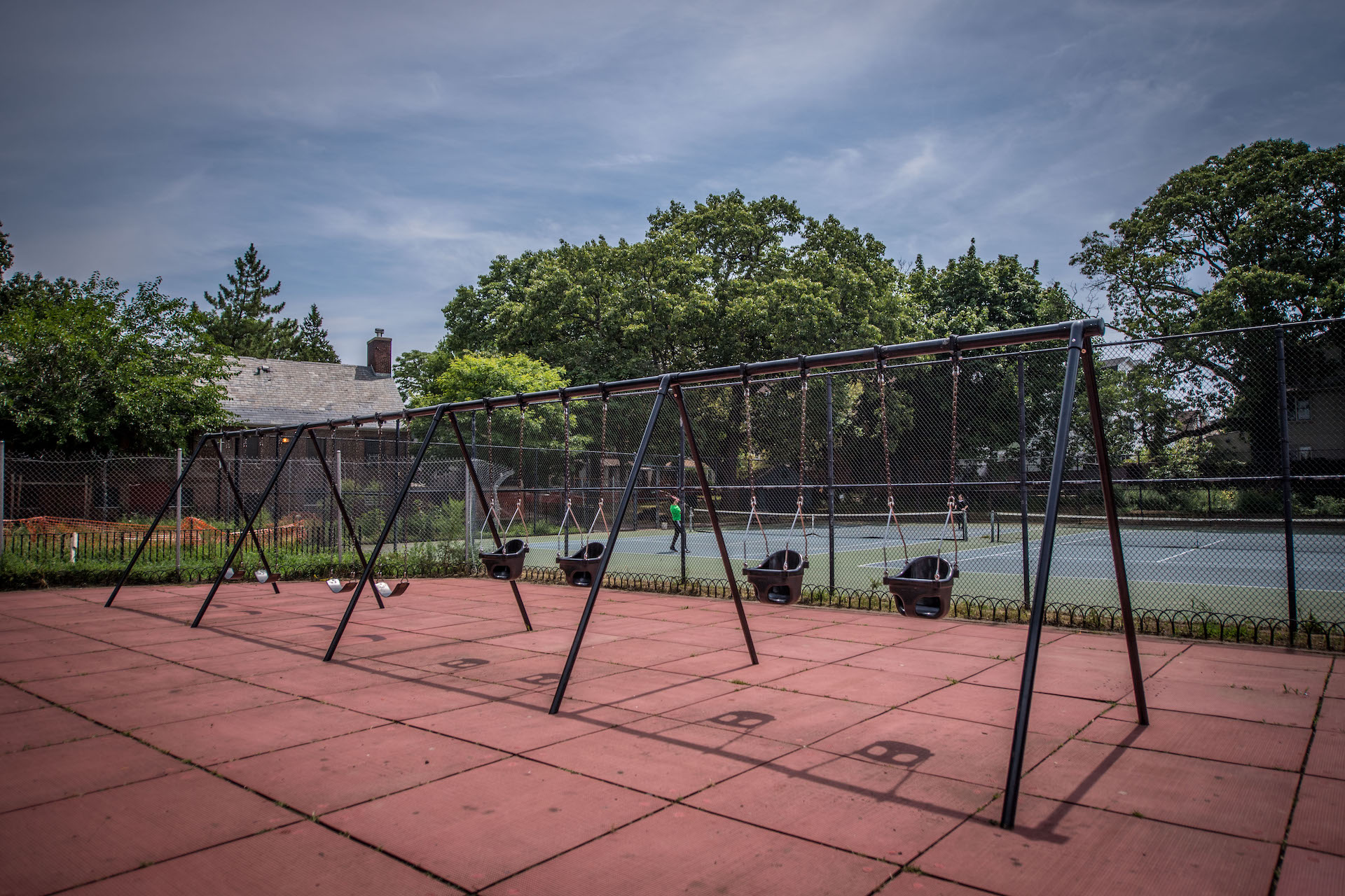 Set of swings near tennis courts at The Vitagraph Apartment park
