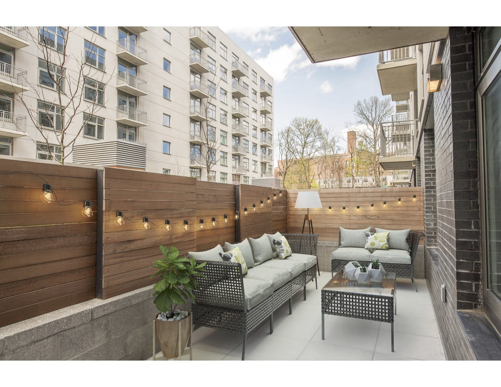 Private outdoor apartment patio with lights at the Vitagraph Brooklyn
