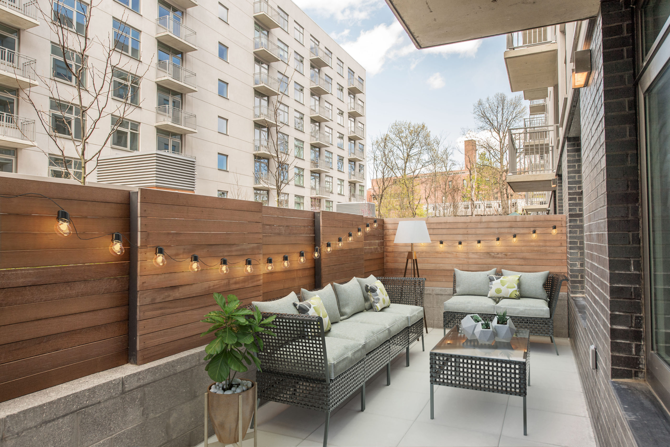 An outdoor patio with luxurious patio furniture at The Vitagraph in Brooklyn, NY