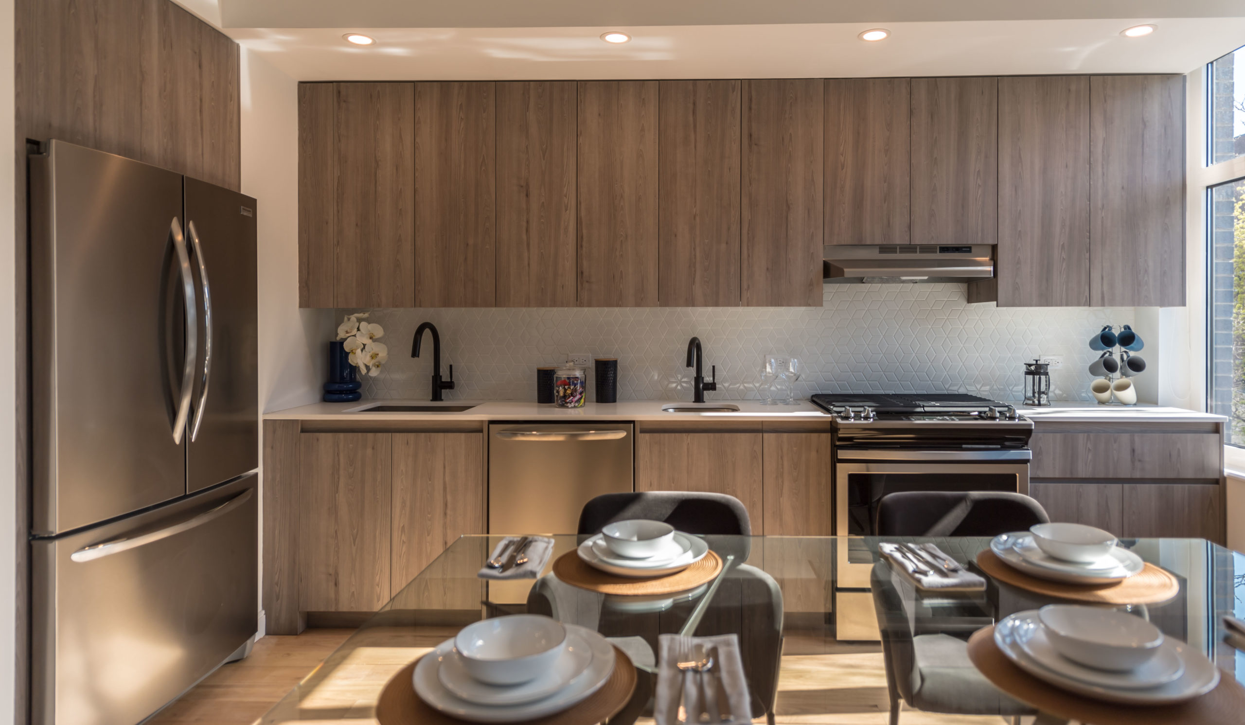 A large kitchen with stainless steel appliances at The Vitagraph Apartments in Brooklyn
