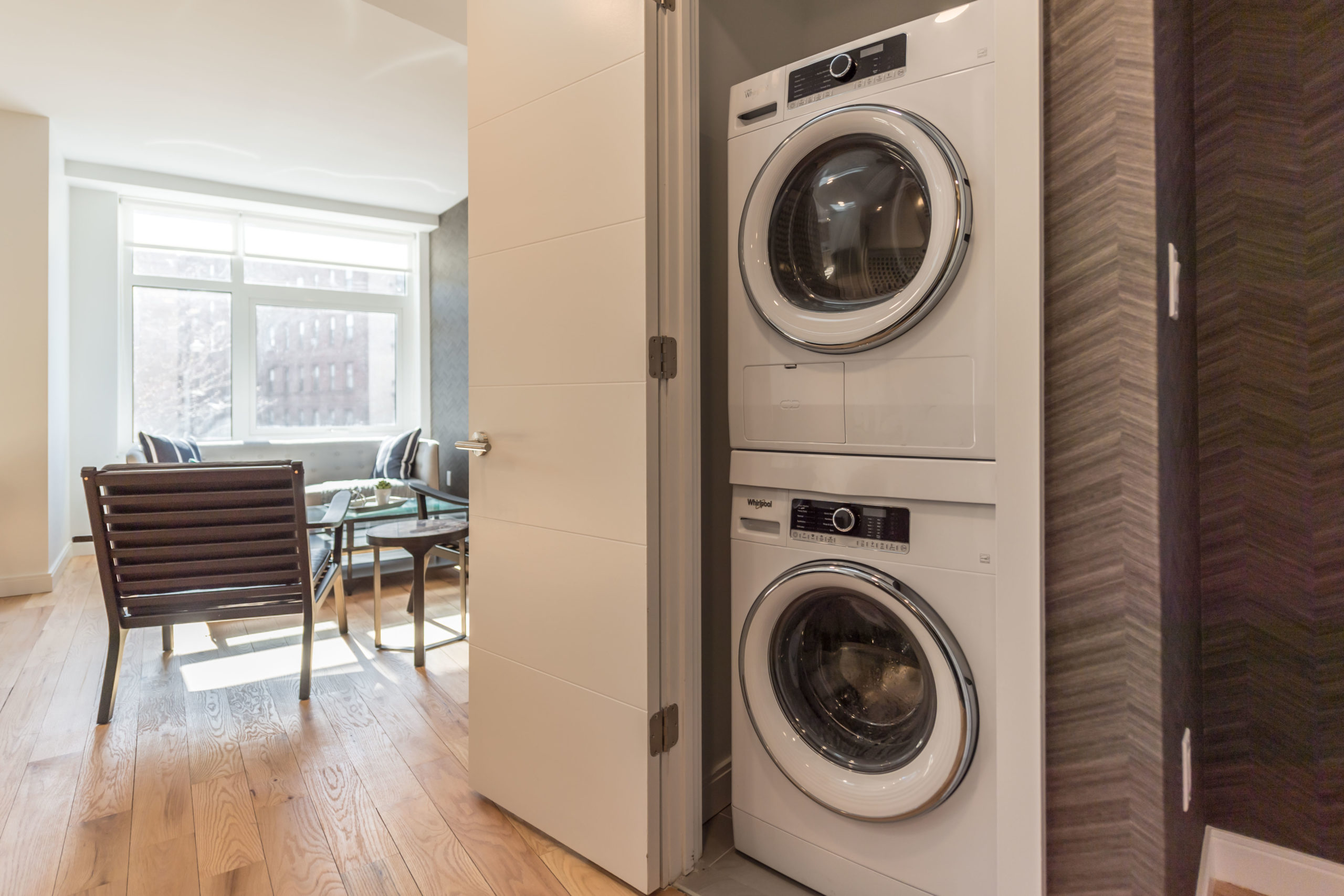 A stacked washer and dryer inside an apartment at the Vitagraph Brooklyn
