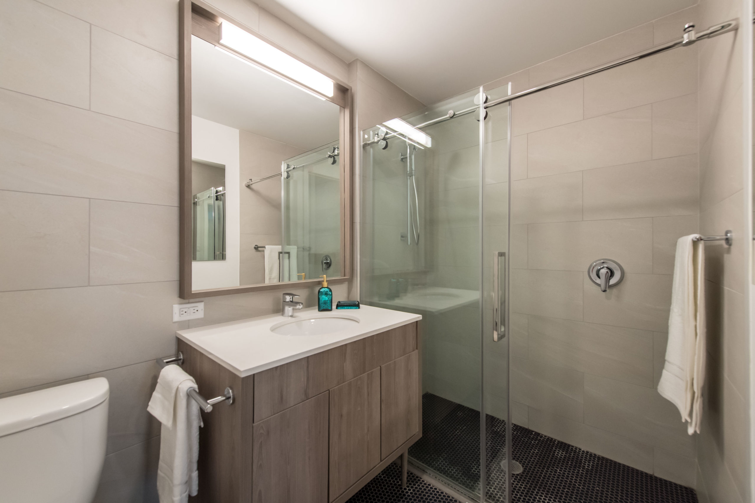 Luxurious tiled shower inside the Vitagraph Apartments in Brooklyn