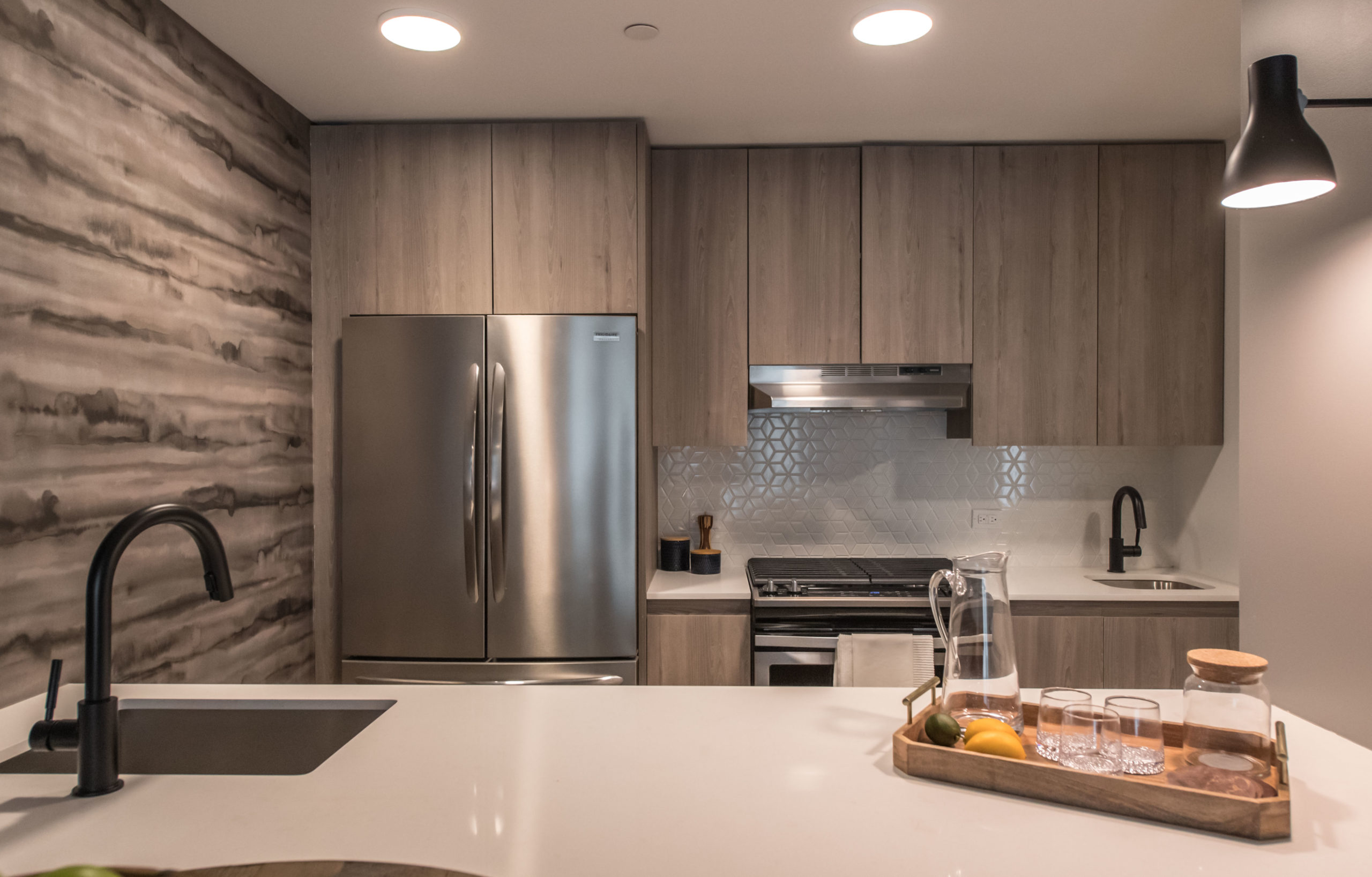 Stainless steel appliances inside a kitchen at The Vitagraph Apartments Brooklyn, NY