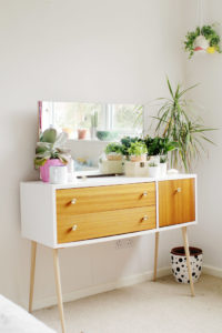A white mid-century modern console table
