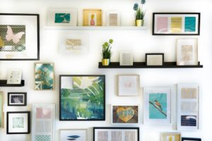 A gallery wall with bohemian style art